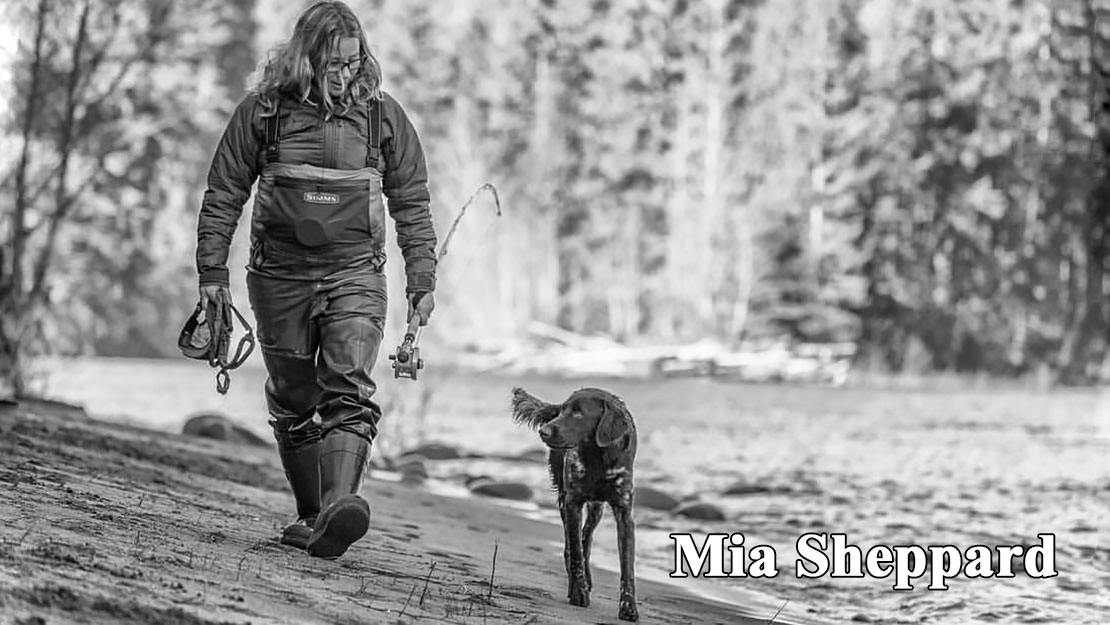 Fly fishing instructor/guide, Mia Sheppard walks back to her car with her dog Cedar.