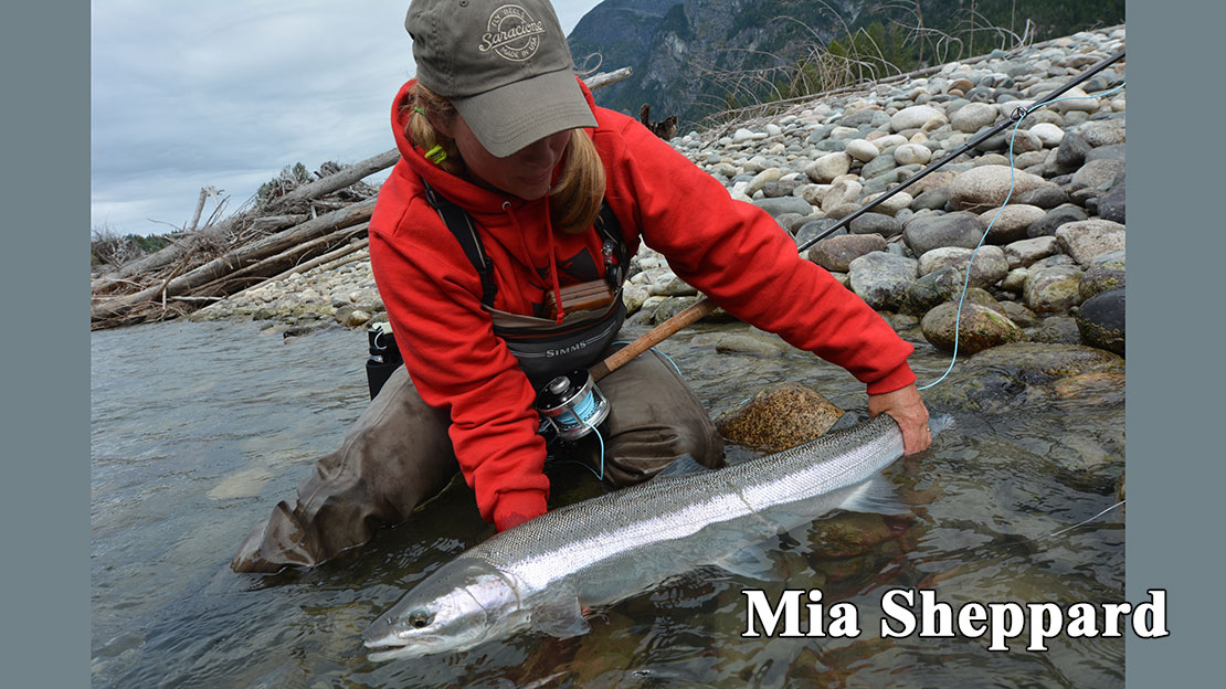 Mia Sheppard tails a huge winter steelhead.