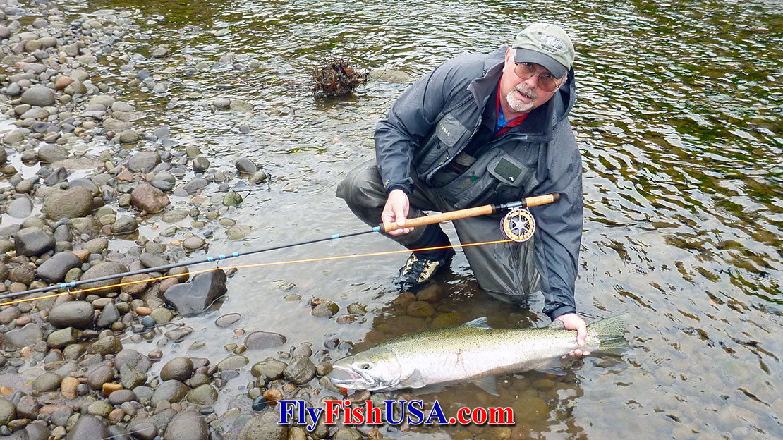 Picture of Mark Bachmann with a winter steelhead caught fromj the Sandy River in Oregon while fly fishing.
