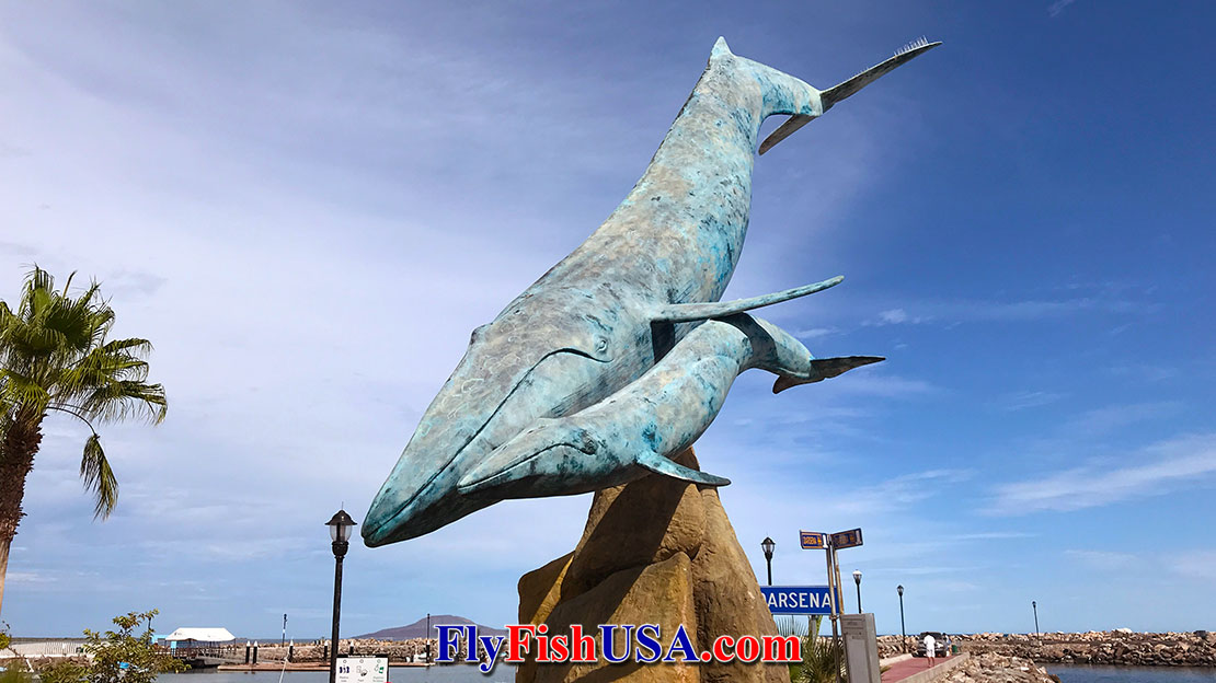 A huge bronze statue of Blue Whales in Loreto, Mexico.