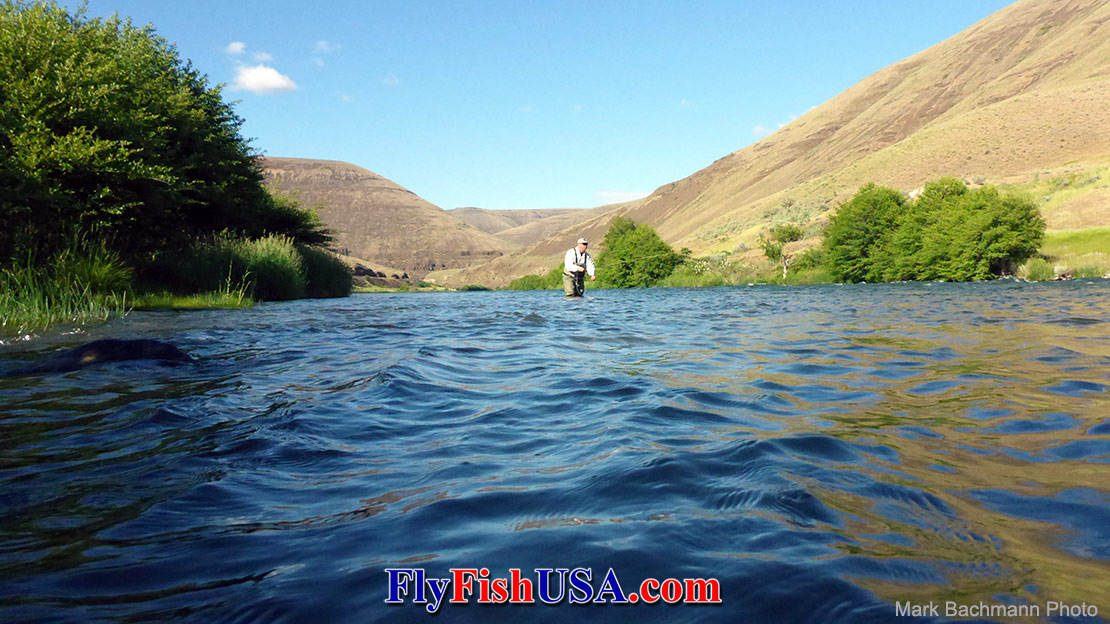 An angle fishes for trout on Oregon's Deschutes River.