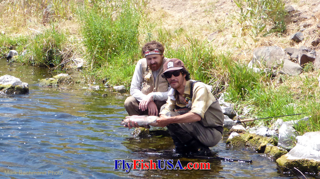 Two young anglers trying an Axiom II rod on Oregon's Deschutes River.