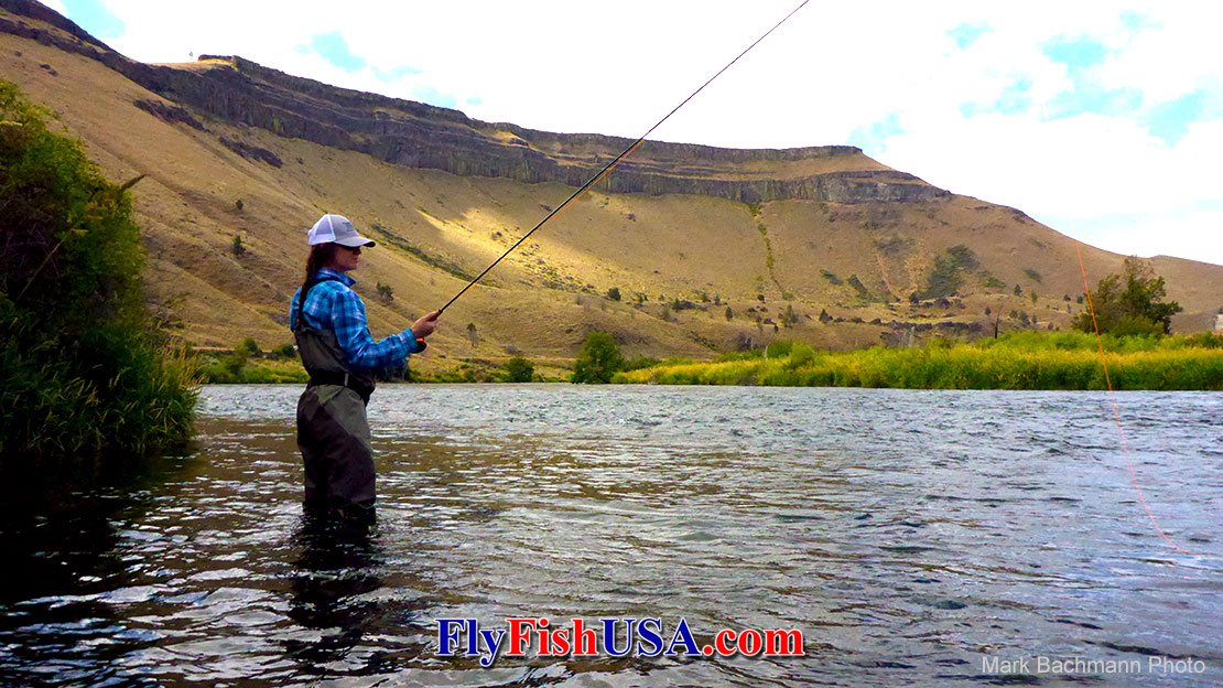 A young women fly fishing for trout on Oregon's Deschutes River with a TFO BVK fly rod.