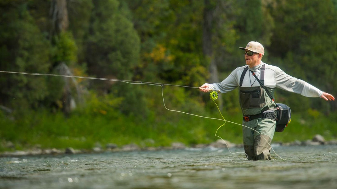 Picture: Anangler wading confidently in Simms Freestone waders.