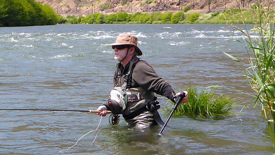 Fly fishing with a wading staff